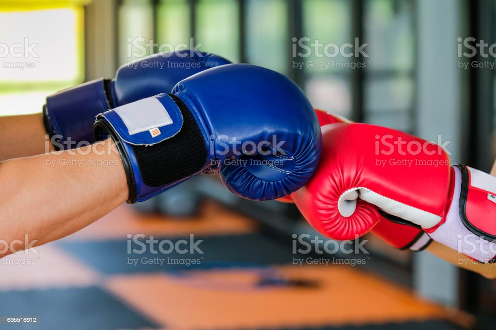 Red and Blue boxing gloves in Gym Fitness stock photo