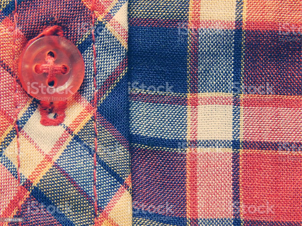 Red and blue checkered shirt, background in vintage colors stock photo