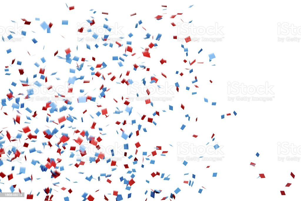 Red and Blue Confetti Falling Against White stock photo