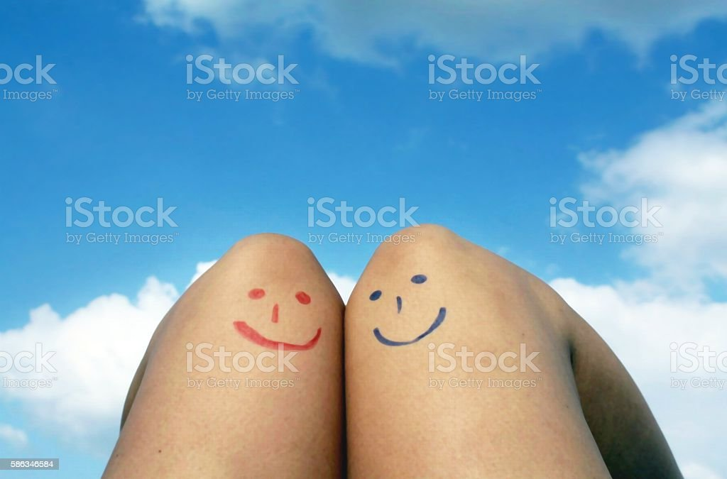 Red and blue emoticons under the sky stock photo