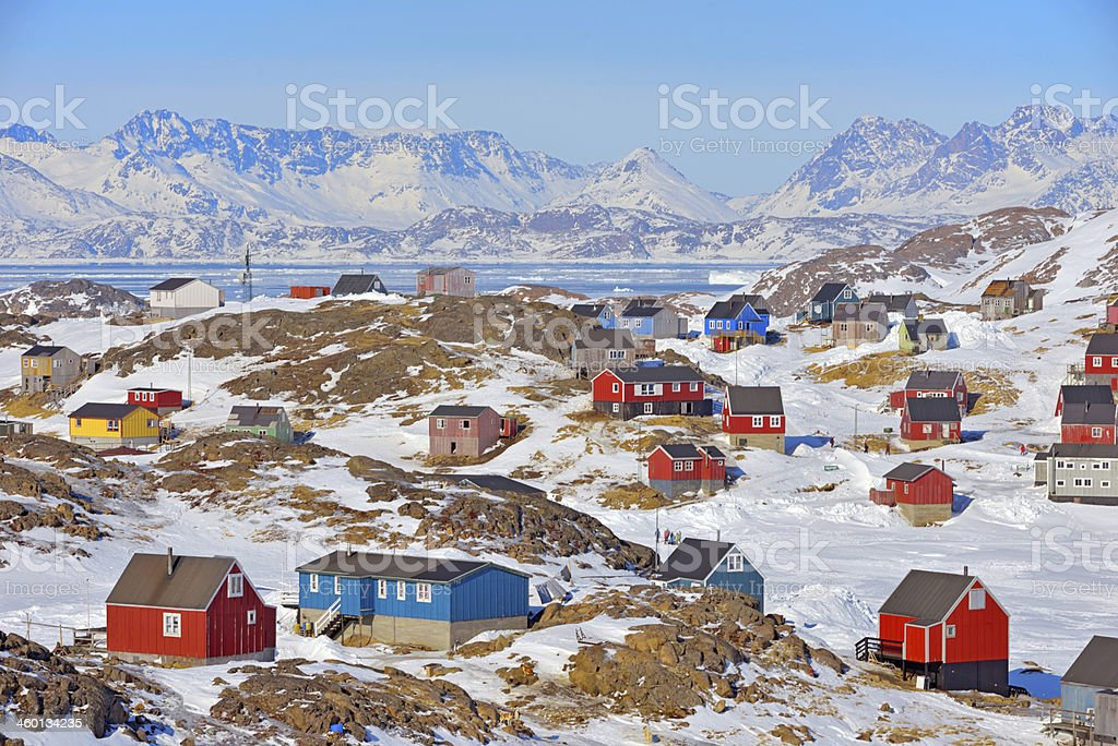 Red and blue houses in the mountains of Greenland stock photo