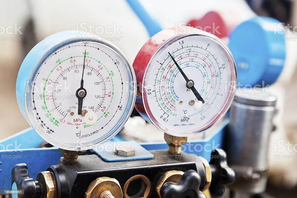 Red and blue manometers in a machine shop stock photo