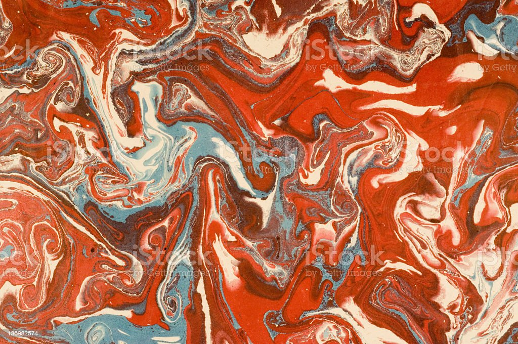 Red and blue marbled paper stock photo