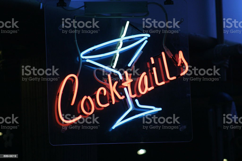 Red and blue neon cocktail sign stock photo