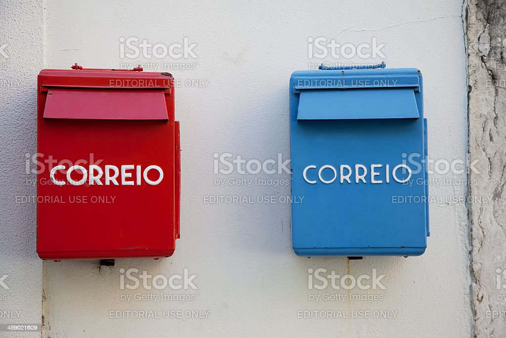 Red and blue post office mailboxes stock photo