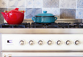 Red and Blue Pots on Pretty Vintage-Style Kitchen Stove