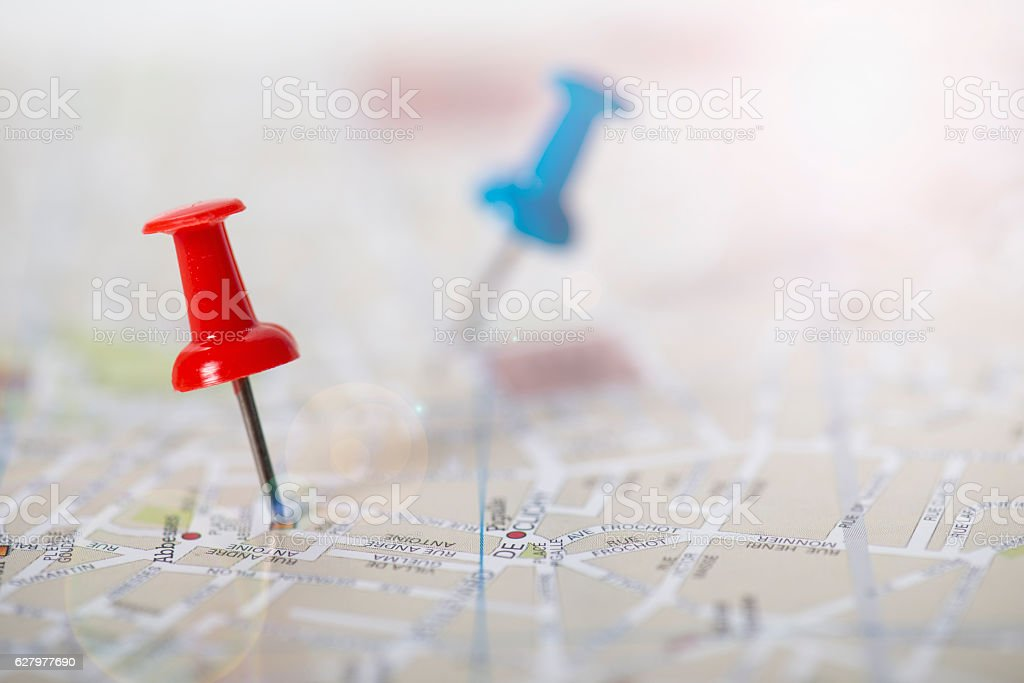Red and blue push pin stuck in a street map stock photo