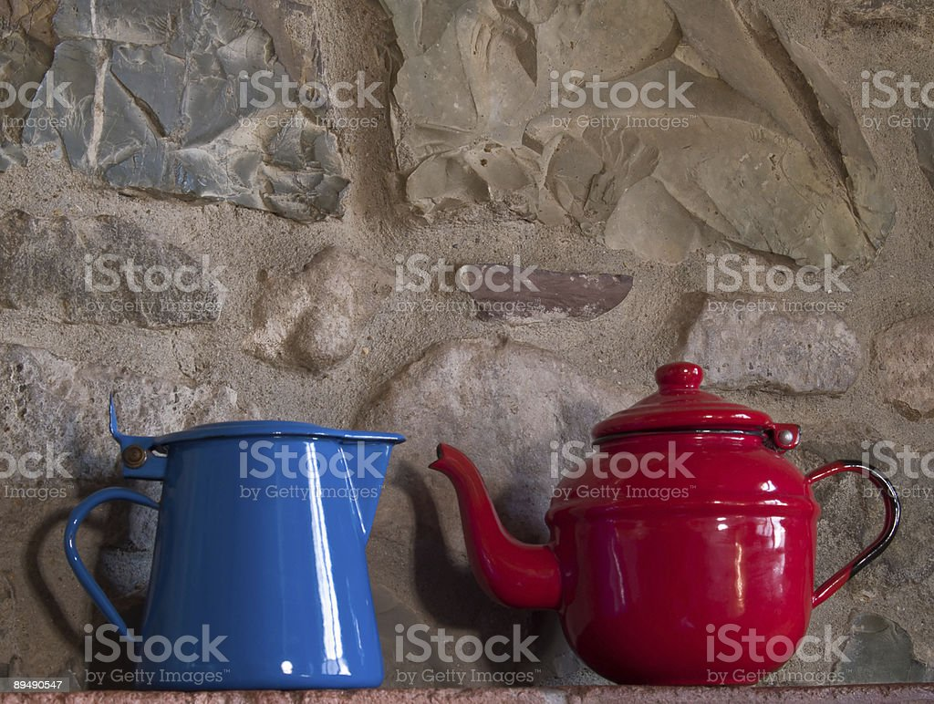 Red and Blue tea Pots stock photo