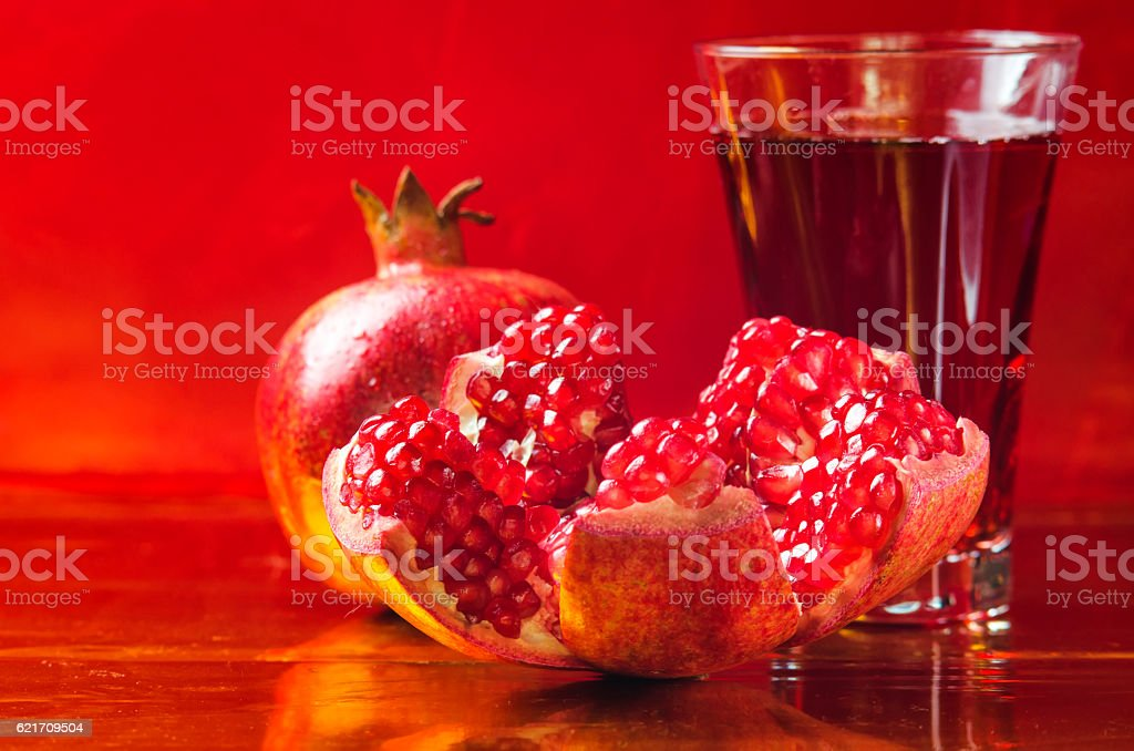 red and fresh pomegranate on a  background stock photo