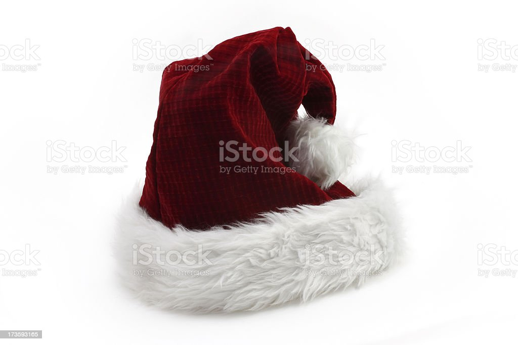 Red and fuzzy santa cap on white background stock photo