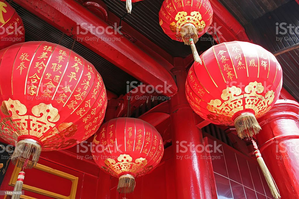 Red and gold Chinese lanterns hanging from temple stock photo
