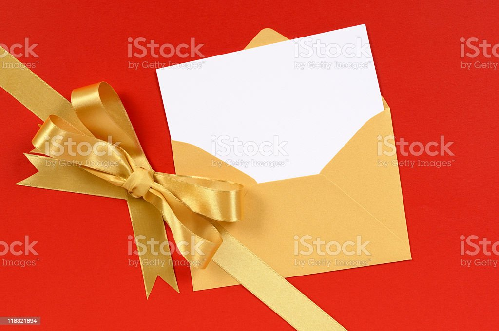 Red and gold gift with blank greetings card royalty-free stock photo