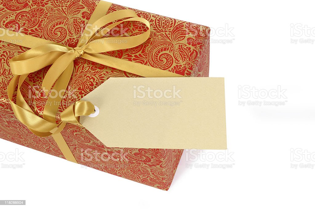 Red and gold gift with tag stock photo