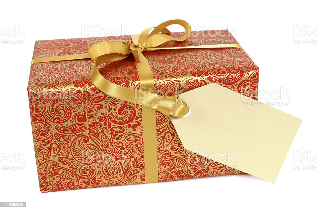 Red and gold gift with tag royalty-free stock photo
