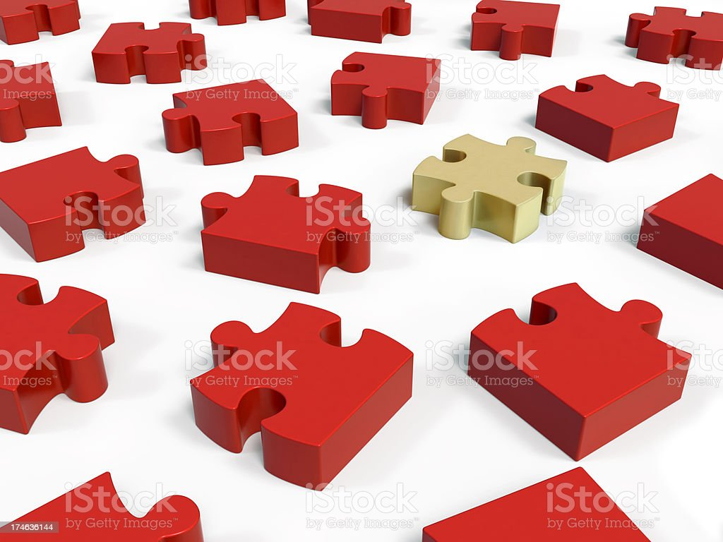 red and gold jigsaw puzzle pieces royalty-free stock photo
