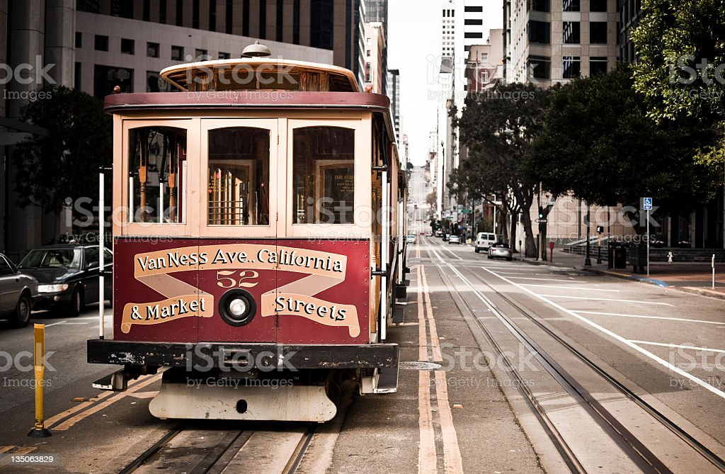 A red and gold street cable car in San Francisco California royalty-free stock photo