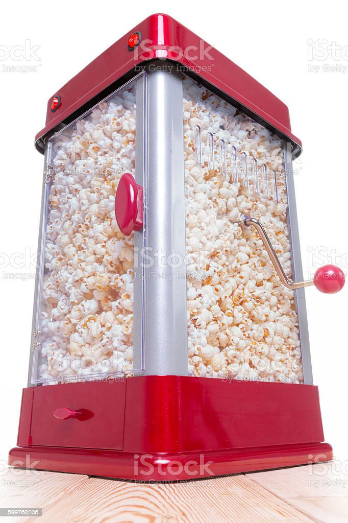 Red and gray full popcorn maker on table stock photo