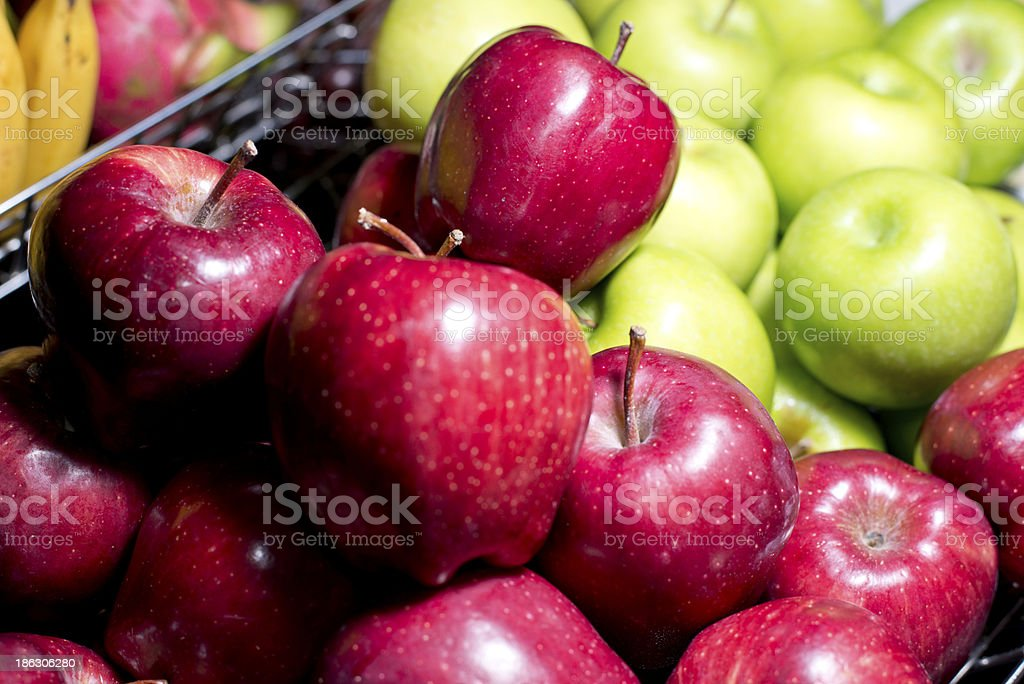red and green apple in steel basket royalty-free stock photo