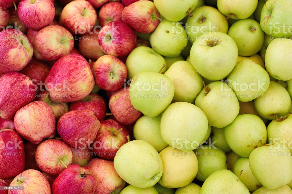 red and green apples background stock photo