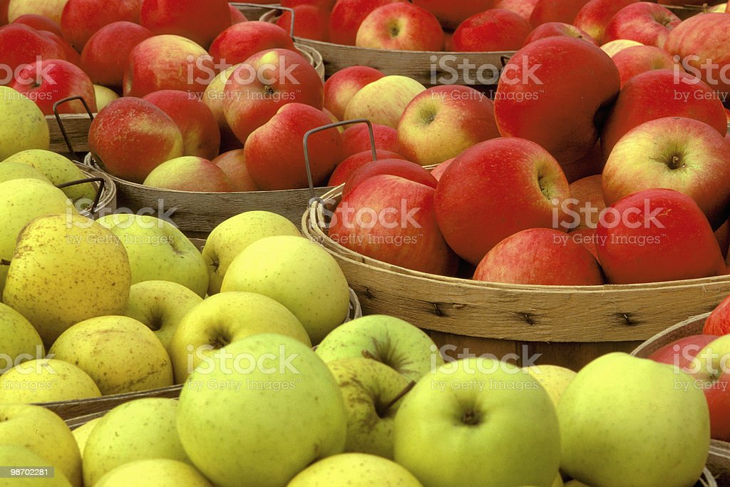 red and green apples in baskets royalty-free stock photo