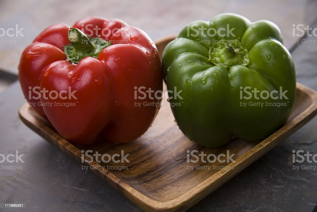 Red and green bell peppers stock photo