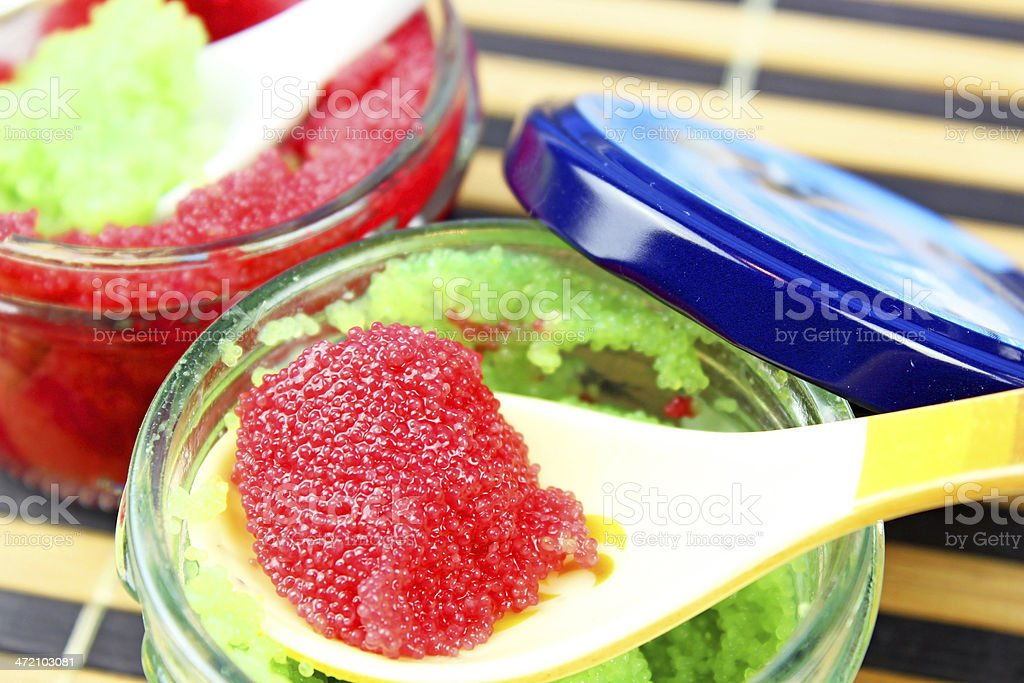 red and green caviar in glass jars stock photo