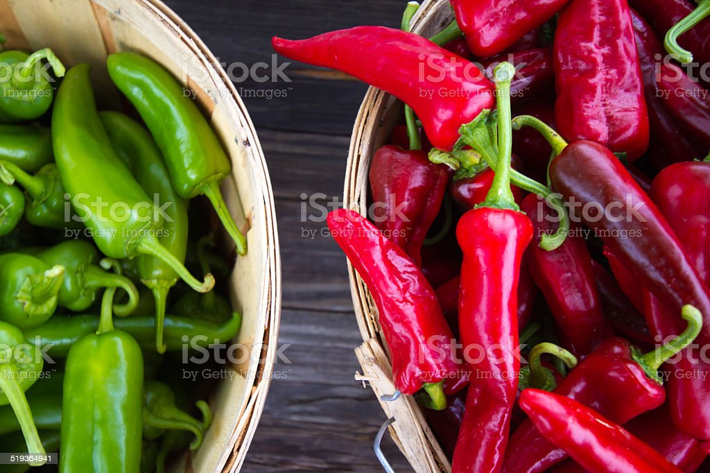 Red and Green Chile Peppers in Bushel Baskets stock photo