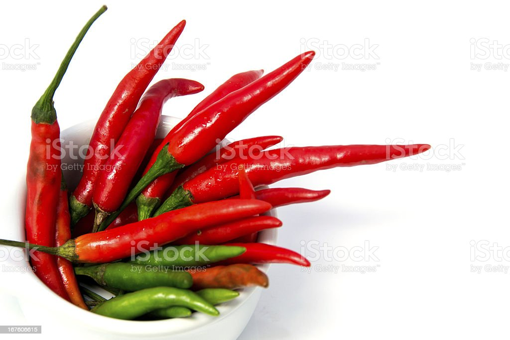 Red and green chili peppers in plate on white background royalty-free stock photo