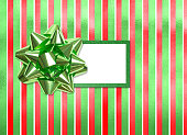 Red and green Christmas package with blank gift tag
