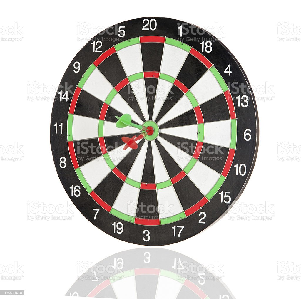 Red and green darts punctured in the center royalty-free stock photo