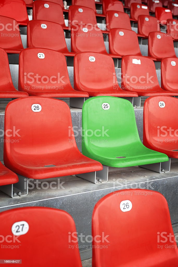 Red and green empty stadium seats royalty-free stock photo