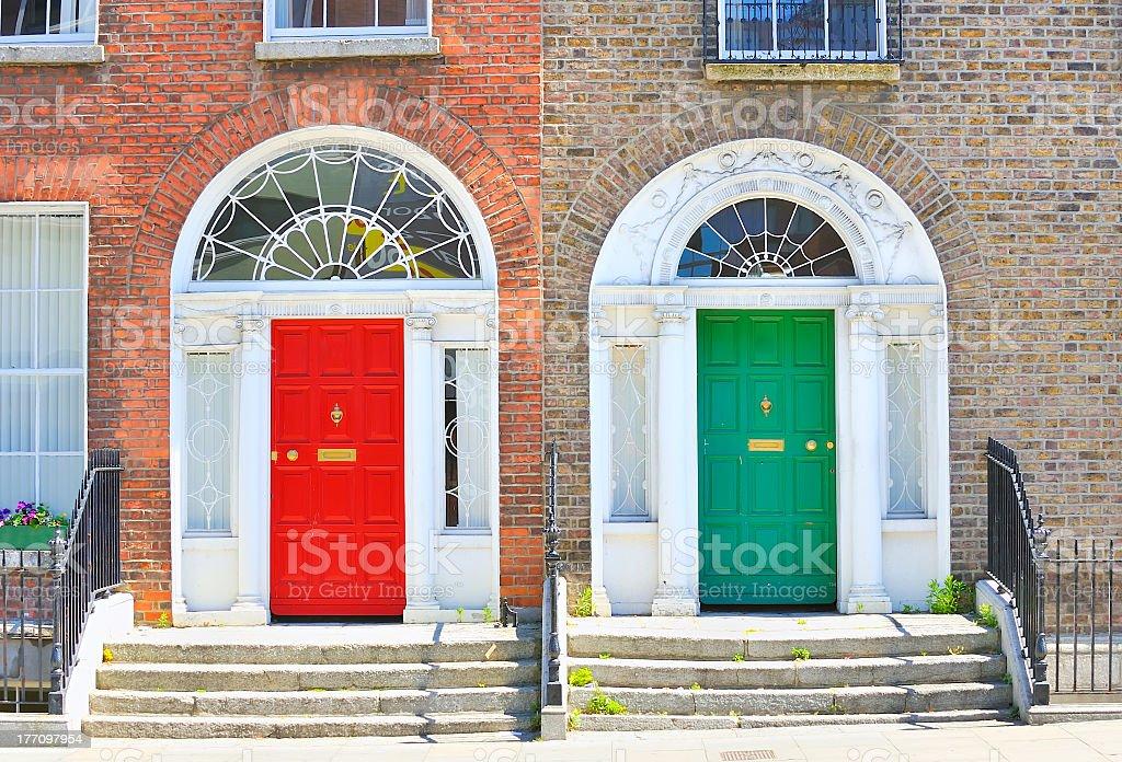 Red and green Georgian doors in Dublin stock photo