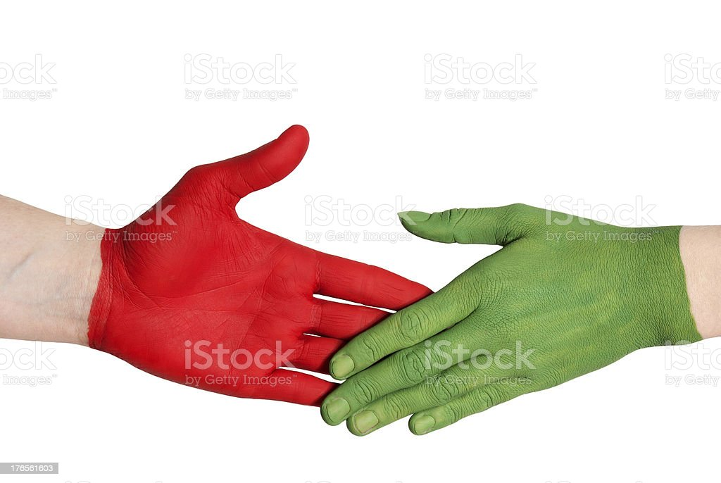 red and green handshake royalty-free stock photo