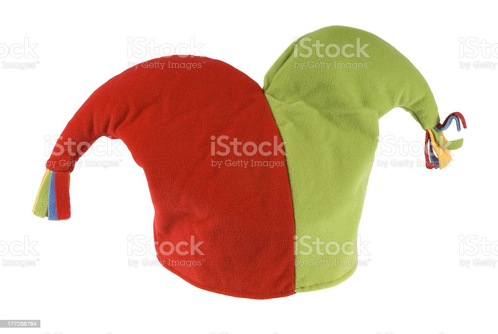 Red and green jester hat isolated on a white background. stock photo