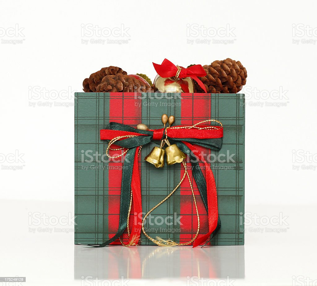 Red and green plaid Christmas box, bows, ribbons, on white. royalty-free stock photo