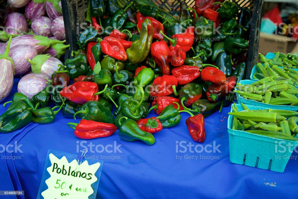 Red and green poblanos peppers stock photo