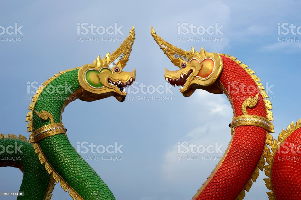 red and green serpent statue stock photo