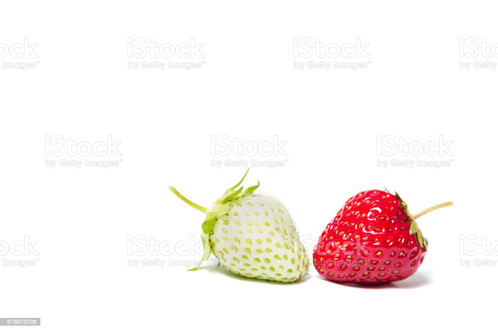 Red and green strawberries lying on a white background stock photo