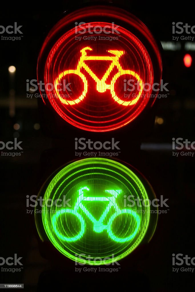 Red and green traffic light for bicyclists at night vector art illustration