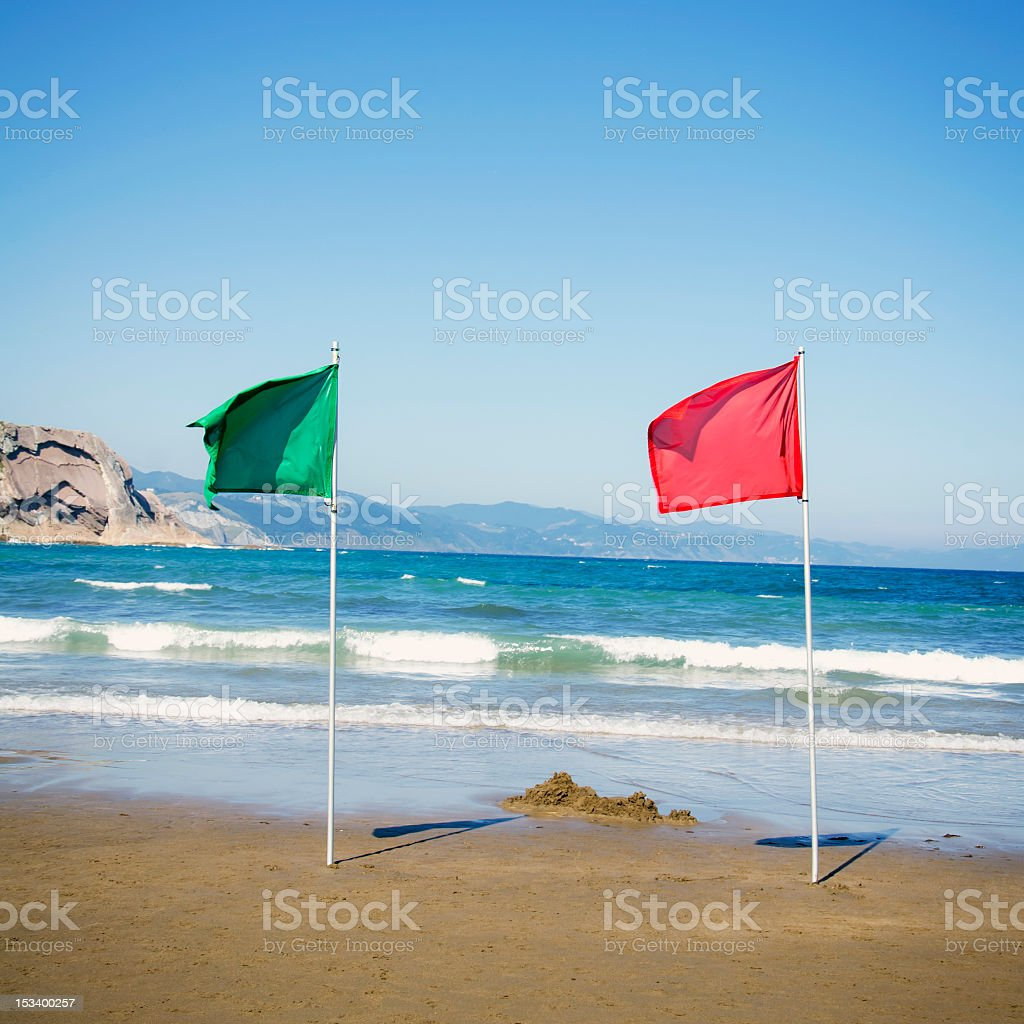 Red and Green Warning Flag at the Beach stock photo