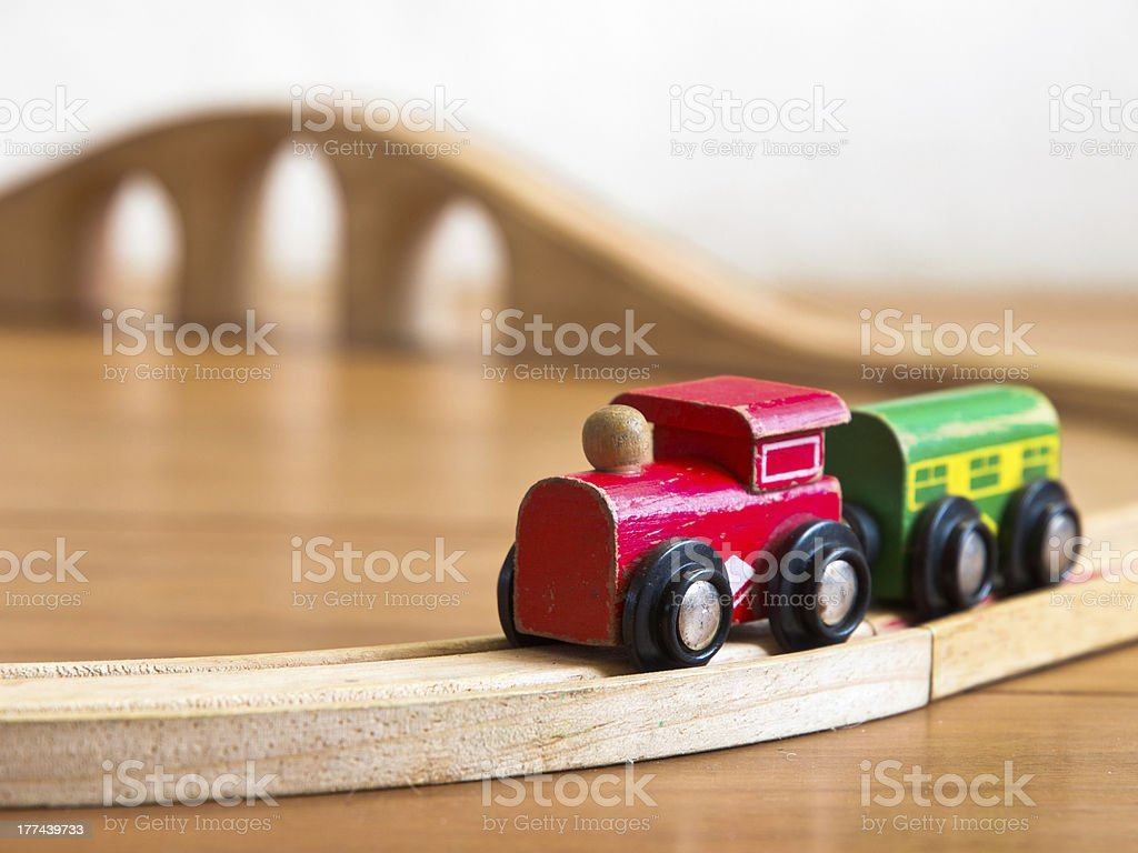 Red and green wooden toy train stock photo