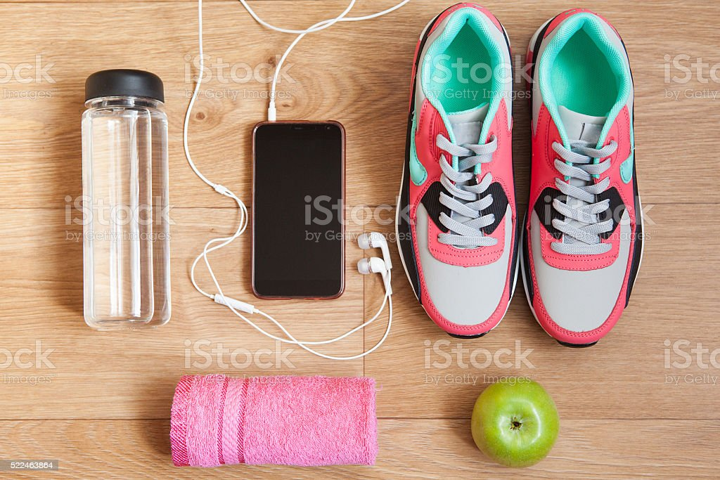 red and grey sneakers with grey shoelaces and red towel stock photo