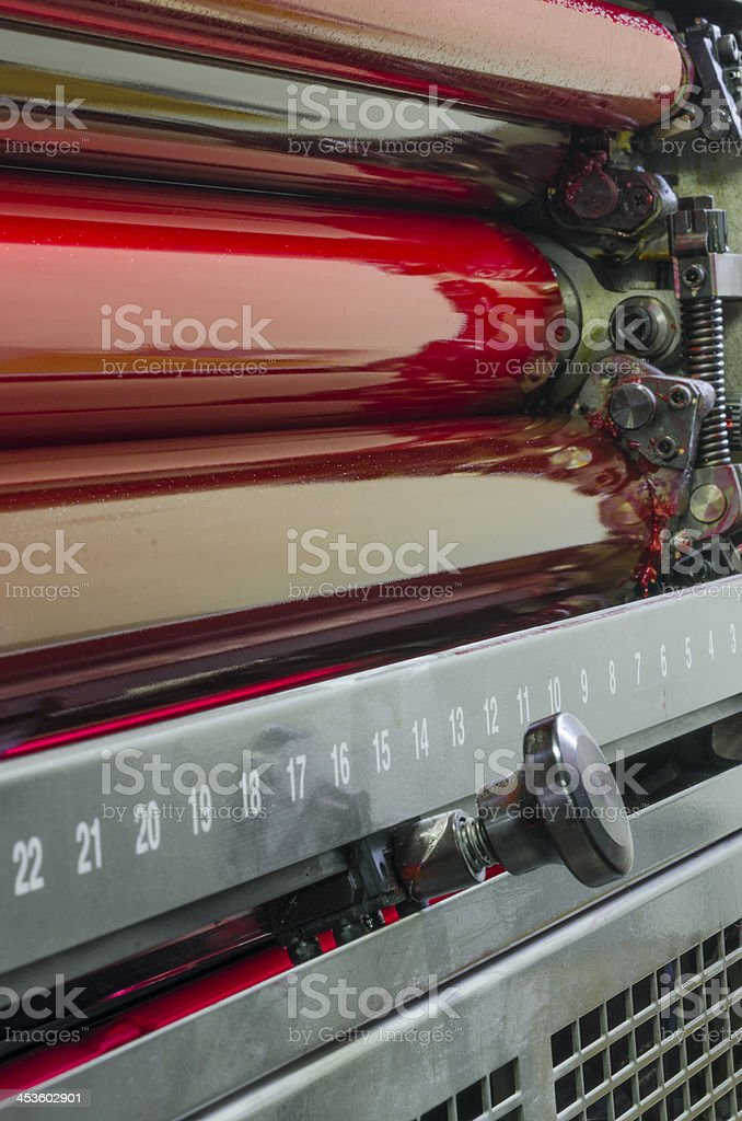 Red and magenta ink color drums in a print machine stock photo
