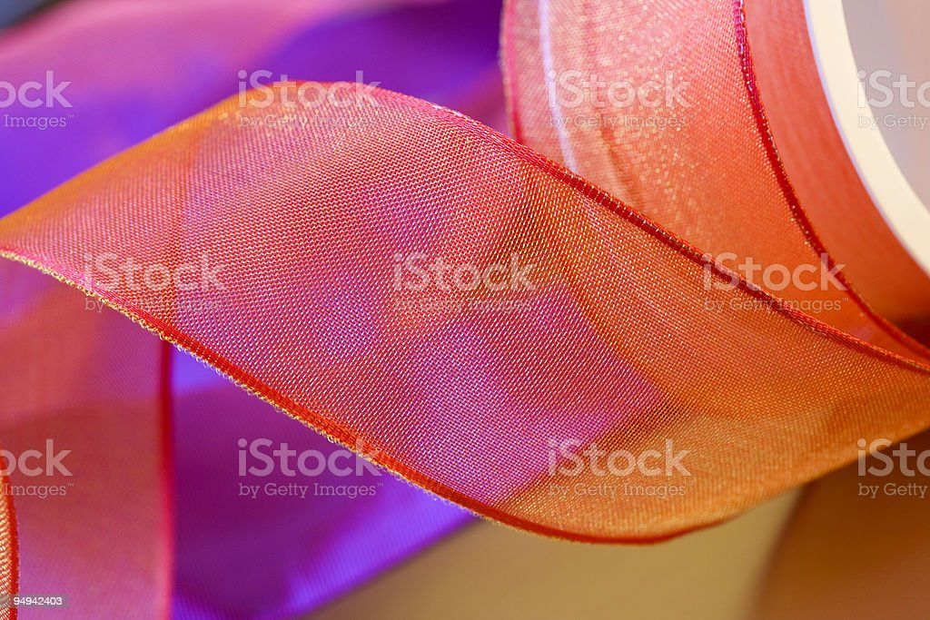 red and orange ribbon bow curls close up royalty-free stock photo