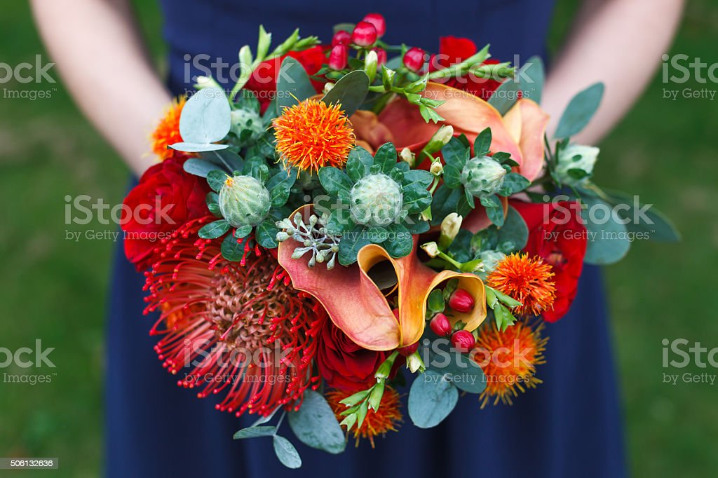 Red and orange wedding bouquet stock photo