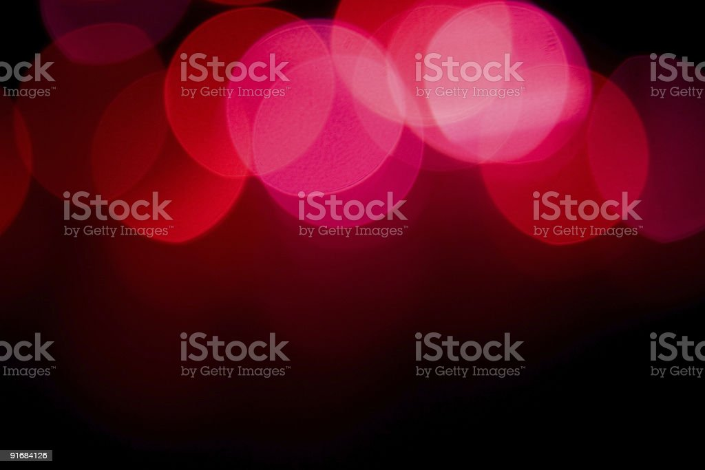 Red and Pink Blurred Bokeh Lights at Top of Background stock photo