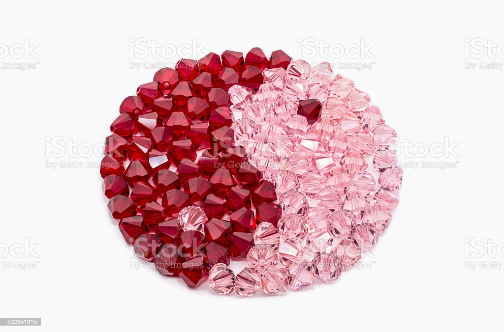 Red And Pink Crystals In Shape Of Ying and Yang stock photo