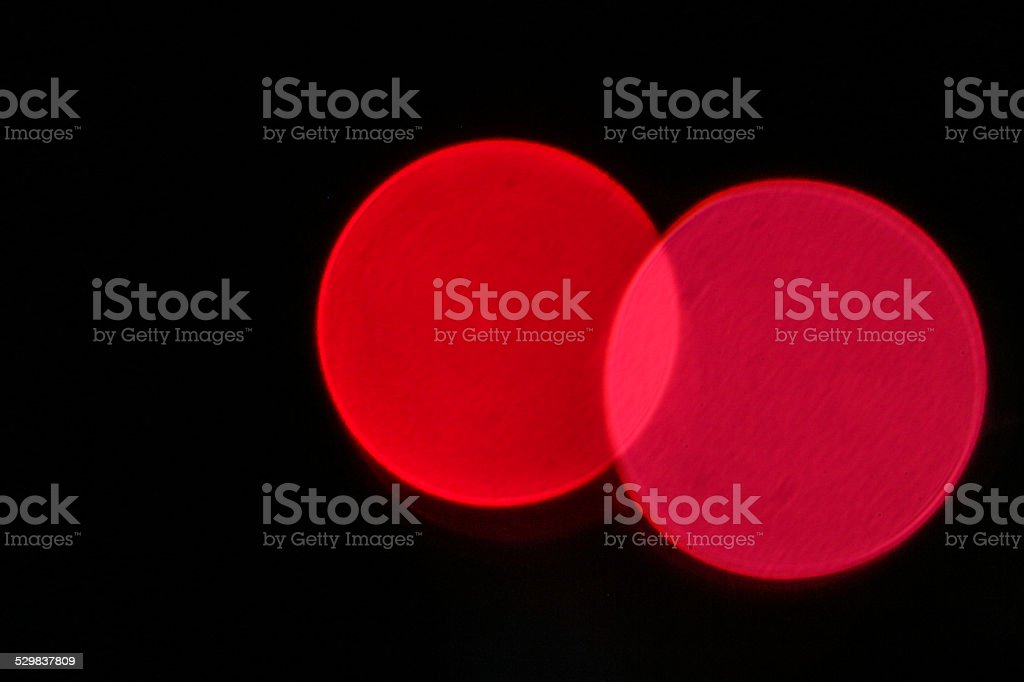 Red and pink defocused light connected stock photo