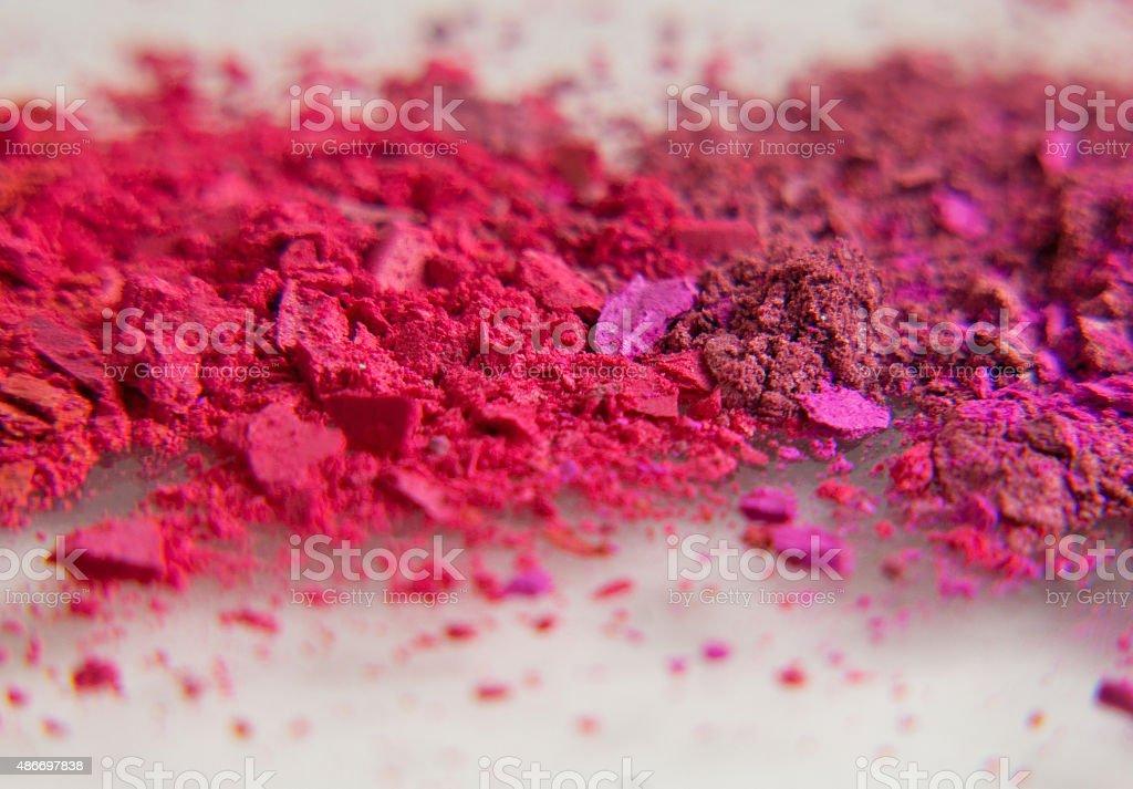 red and pink eyeshadow broken powder stock photo