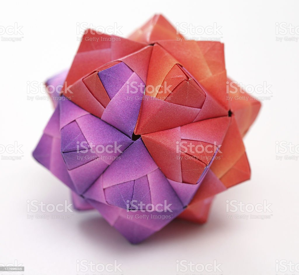 Red and purple geometric origami polyhedron paper craft royalty-free stock photo